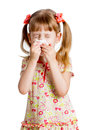Kid girl wiping or cleaning nose with tissue isolated on white Royalty Free Stock Photos