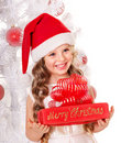Kid giving Christmas gift box. Royalty Free Stock Photo