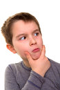 Kid giving suspicious look wonder what thinks Stock Images