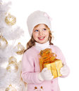 Kid with gold christmas gift box child in hat and mittens holding near white tree isolated Royalty Free Stock Photos