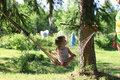 Kid In Hammock On Nature