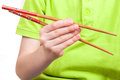 The kid hand with chopstick holds traditional asian Royalty Free Stock Images