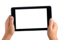 Kid hands holding tablet pc seven inches in landscape position with blank white screen displayed towards the camera all isolated Royalty Free Stock Photos