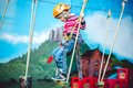 Kid having a good time and having fun at an adventure playground with diferent activities. Happy childhood concept Royalty Free Stock Photo