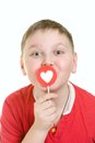 Kid with heart shaped lollipop on white background Royalty Free Stock Photos
