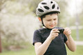 Kid in helmet looking at phone camera Stock Images
