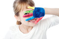 Kid hiding face with her colored hand beautiful girl from camera Stock Photo