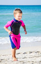 Kid in his diving suit leaving water at the beach small boy Royalty Free Stock Images