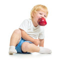 Kid holding apple in mouth on white Stock Image