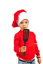 Kid holding kitchen utensil happy boy isolated on white background Royalty Free Stock Photo