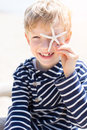 Kid holding starfish Royalty Free Stock Photo