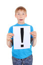 Kid holds exclamation mark surprised a sheet with isolated on the white background Stock Photos