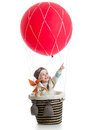 Kid on hot air balloon with pointing hand up Royalty Free Stock Photo
