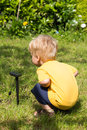 Kid interested by solar battery little child in his garden Stock Photos