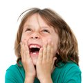 Kid laughing with hands on face. Royalty Free Stock Photo