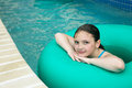 Kid on a lazy river location shot of young girl blue green innertube in in myrtle beach south carolina Stock Photo