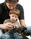 Kid learning photography Stock Image