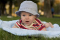 Kid lies on a tummy baby outdoors Royalty Free Stock Photos