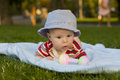 Kid lies on a tummy baby outdoors Stock Photography