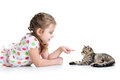 Kid lying on floor and playing with cat Royalty Free Stock Photo