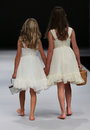 Kid models walk runway at Ivy and Aster fashion show during Fall 2015 Bridal Collection Royalty Free Stock Photo