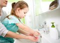 Kid with mom washing hands Royalty Free Stock Photos