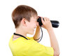 Kid with monocle curious isolated on the white background Royalty Free Stock Photography