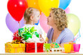 Kid and mother celebrate birthday holiday girl Royalty Free Stock Photo