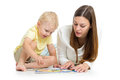 Kid and mother play together with puzzle toy Royalty Free Stock Photo