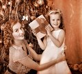 Kid with mother receiving gifts Stock Photography