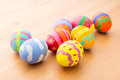 Kid painted easter egg over wooden background Royalty Free Stock Image