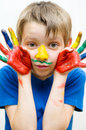 Kid with painted hands portrait of a cute boy Royalty Free Stock Photos