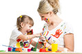 Kid with parent paint together Royalty Free Stock Photo