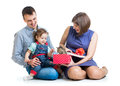 Kid and parents play with cat kitten girl her Stock Photo