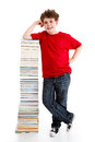Kid and pile of books young boy standing next to on white background Stock Images