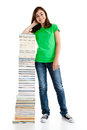 Kid and pile of books young girl standing next to on white background Stock Images