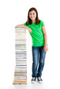 Kid and pile of books young girl standing next to on white background Royalty Free Stock Photography