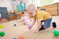 Kid playing with balls in kindergarten Royalty Free Stock Photo
