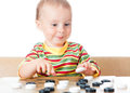 Kid playing checkers. Stock Photography