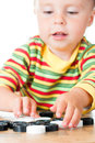 Kid playing checkers. Royalty Free Stock Photography