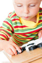 Kid playing checkers. Royalty Free Stock Image