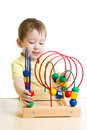 Kid playing with color educational toy boy Royalty Free Stock Images