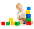 Kid playing with colorful blocks sitting on floor Royalty Free Stock Photography
