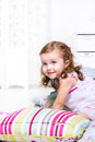 Kid playing with pillows Royalty Free Stock Photography
