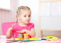 Kid playing with play clay at home or playschool Royalty Free Stock Photo