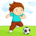 Kid playing Soccer Stock Image