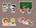 Kid playing stickers Stock Photo