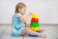 Kid playing toy blocks