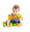 Kid playing toy blocks on white background Royalty Free Stock Photography