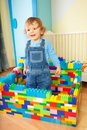 Kid playing with toy blocs Royalty Free Stock Photo